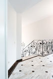 Style hotel hallway. French style classic hotel hallway with paintings and wrought iron railing Royalty Free Stock Photo