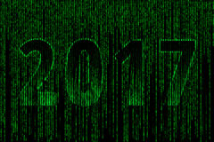 2017 of style matrix. 2017 in the style of matrix, figure 2017 consisting of different symbols letters and numbers with a background in matrix style Stock Images