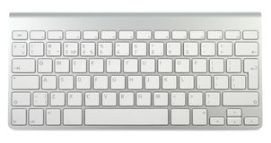 Style Metallic Keyboard. Wireless metallic keyboard isolated with clipping path over white background Royalty Free Stock Images