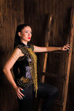 Style model woman on a wooden background. Royalty Free Stock Photography