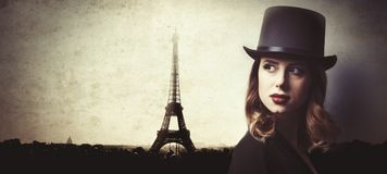 Style and mystique redhead girl in top hat Stock Photos