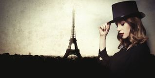 Style and mystique redhead girl in top hat Stock Photo