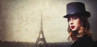 Style and mystique redhead girl in top hat Stock Image