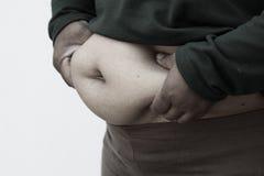 Style noir et blanc de photo pour le plan rapproché de la grosse femme sur le fond blanc Concept pour la question d'obésité, régi Image libre de droits
