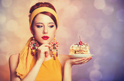 Style redhead girl with cake. Royalty Free Stock Photo
