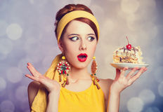 Style redhead girl with cake. Stock Photos
