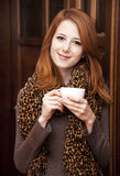 Style redhead girl drinking coffee Stock Photo