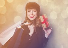 Style redhead girl in hat with shopping bags and gift box Royalty Free Stock Photo