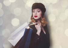 Style redhead girl in hat with shopping bags Stock Photo