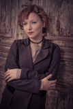Style redhead girl leaning old wooden door Royalty Free Stock Photo