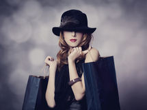 Style redhead girl with shopping bags. Royalty Free Stock Photo