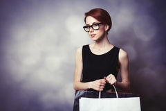 Style redhead girl with shopping bags Royalty Free Stock Photos