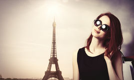 Style redhead girl with shopping bags Stock Images