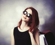Style redhead girl with shopping bags Stock Photography