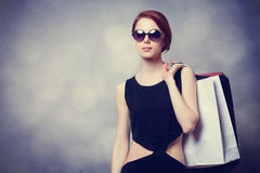 Style redhead girl with shopping bags Stock Photo