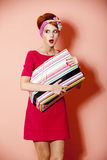 Style redhead girl with shopping box at pink background. Stock Photos