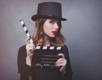 Style redhead girl in top hat with movie clapperboard Royalty Free Stock Photo