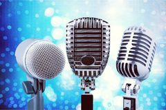 Retro style microphones on  background. Style retro mic microphones background holiday equipment Royalty Free Stock Photo