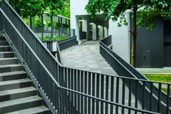 Style in Singapore street architecture. Geometrical shapes of steel. Empty stair and ramp construction in modern city. Cityscape in Singapore. Hightech and royalty free stock images
