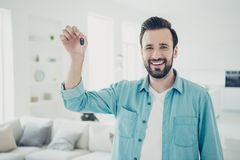 Style stylish trendy charming cheerful bearded man stand in blue stock images