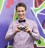 Style teen boy near graffiti background. Stock Photo