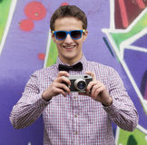 Style teen boy near graffiti background. Stock Photography
