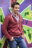Style teen boy near graffiti background. Stock Photo