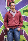 Style teen boy near graffiti background. Stock Image