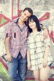 Style teen couple near graffiti background. Stock Photo