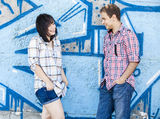 Style teen couple near graffiti background. Royalty Free Stock Photography