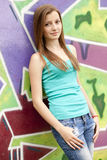 Style teen girl near graffiti background. Royalty Free Stock Images