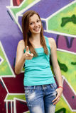 Style teen girl near graffiti background. Royalty Free Stock Photography