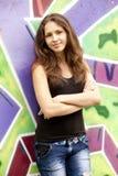 Style teen girl near graffiti background. Stock Photo