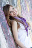 Style teen girl near graffiti wall. Stock Photography