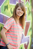 Style teen girl near graffiti wall. Stock Image