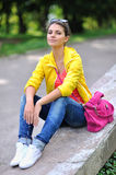 Style teen girl sitting in a park Royalty Free Stock Photography
