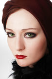 Style of twenties. Portrait of beautiful green-eyed girl with makeup in twenties style Royalty Free Stock Image