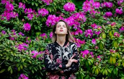 Style woman near rhododendron flowers in a grarden stock photography