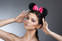 Style woman portrait perfect face, professional make. fashion mouse with big ears. Royalty Free Stock Photography