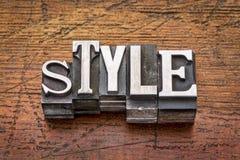 Style word in  metal type. Style word in mixed vintage metal type printing blocks over grunge wood Stock Photo