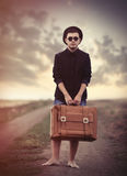 Style young man with suitcase Stock Photography