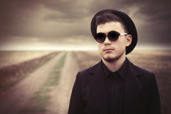 Style young man in sunglasses and hat Stock Image