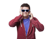 Style young man in sunglasses with mobile Stock Photo