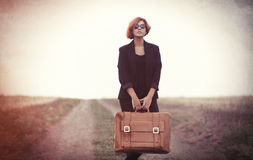 Style young woman with suitcase Stock Image