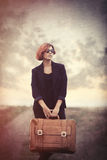 Style young woman with suitcase Royalty Free Stock Photos