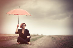 Style young women with umbrella at countryside Stock Photos