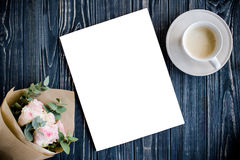 Styled background with coffee, smartphote, roses and magazine co. Dark styled background with coffee, smartphote, roses and magazine cover mock-up on black Royalty Free Stock Images