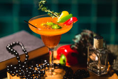 Styled cocktail drink with lime, capsicum and rosemary Royalty Free Stock Photo