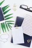 Styled design office workspace desk with camera. Top view flat lay office workspace desk styled design office supplies tropical palm leaves smartphone copy space stock image