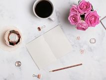 Coffee, flowers, gold colored stationery and blank notepad, top. Styled desktop. Coffee, flowers, gold colored stationery and blank notepad, top view Stock Photo